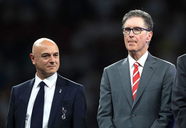 Tottenham Hotspur chairman Daniel Levy (left) stands with current Liverpool owner John W. Henry (centre)