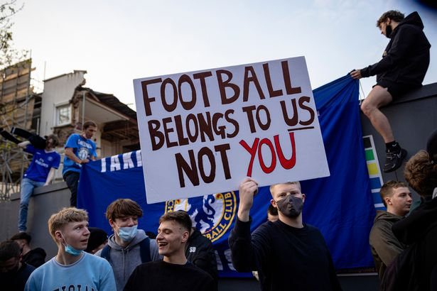 Chelsea Football Club fans celebrate outside the team's Stamford Bridge stadium on April 20, 2021 in London, England, after it was announced that Chelsea Football Club would seek to withdraw from the new European Super League