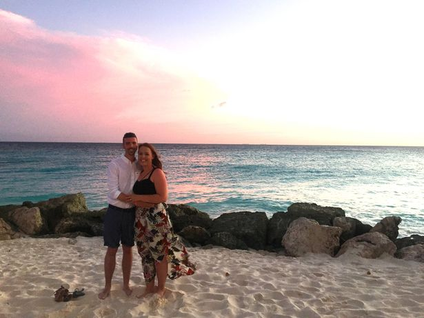 Chloe Carmichael in sunset holiday photo with husband
