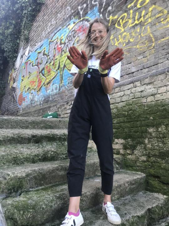 flora wearing gloves