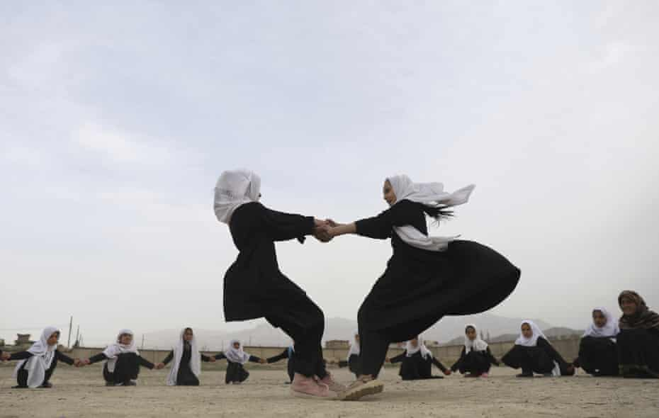 Afghan girls play in a primary school playground in Kabul in March. Schools have only recently begun reopening.