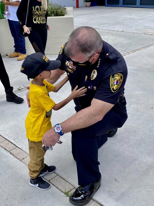 Jeremiah Valera hugging North Miami Police Department Chief Larry Juriga