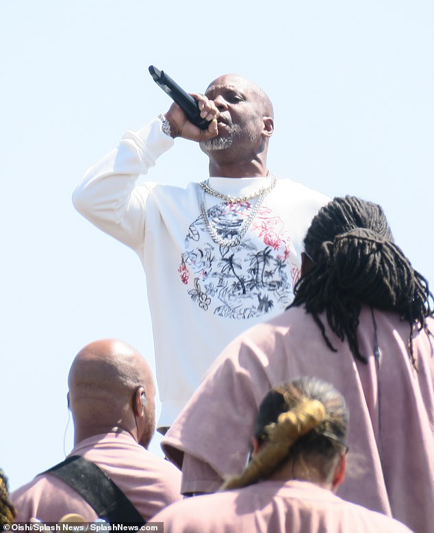 Glory: The rapper is seen above performing at Kanye West's Sunday Service at the Mountain at Coachella in 2019