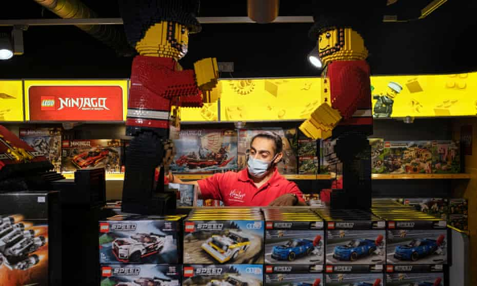 A member of staff at Hamleys in central London prepares to reopen after the third lockdown