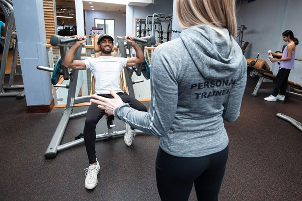 Personal trainer Bella Gordijenko instructs Arthik Francis in the gym at David Lloyd Cambridge as gyms reopen Monday