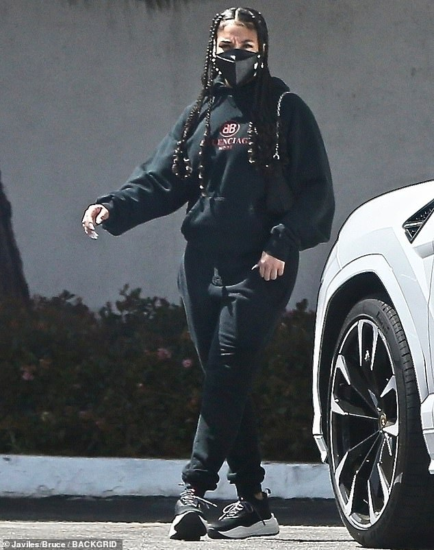 Keeping cozy: The daughter of Steve Harvey wore a slightly oversized Balenciaga hoodie and a matching pair of sweats while stepping out