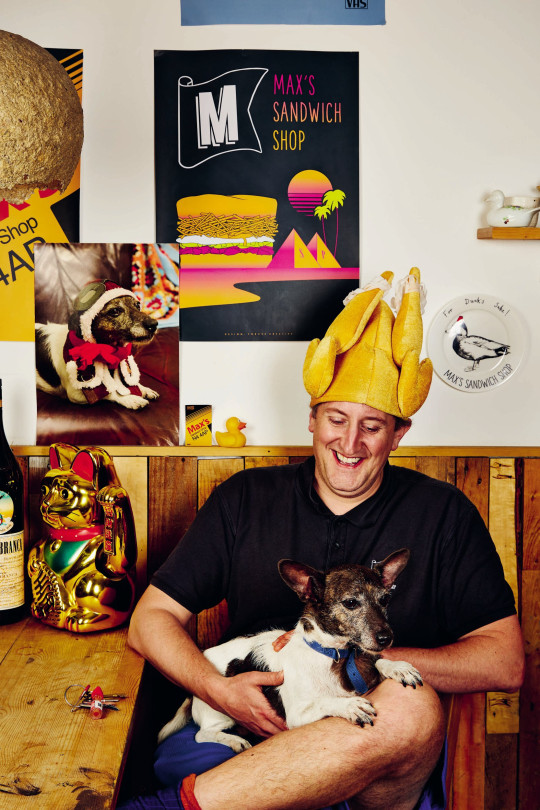 Max Halley with dog and novelty roast chicken hat