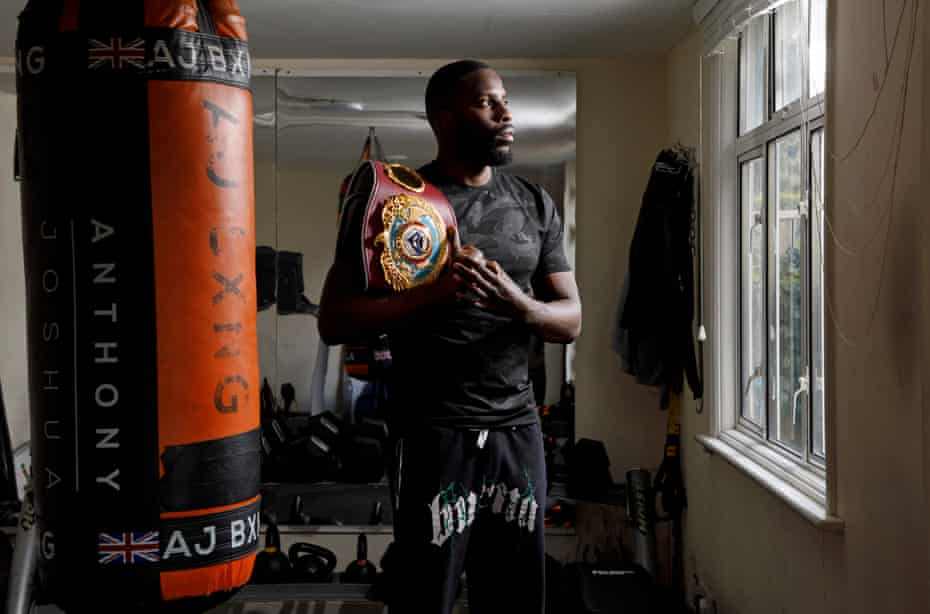 Lawrence Okolie in the tiny gym at the bottom of his garden in Woodford Green, London
