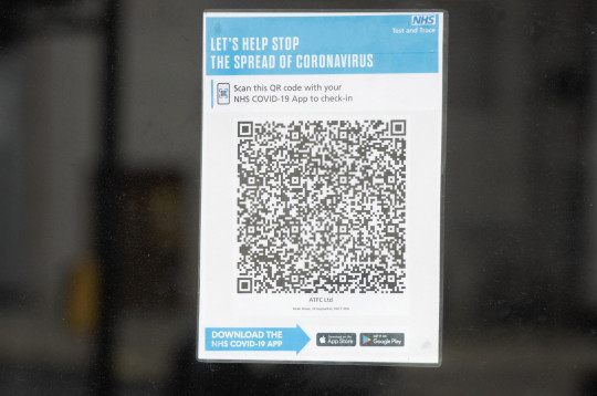 A sign asking patrons at a restaurant to scan a QR code for contact tracing purposes on the NHS app which has become a ubiquitous symbol of restaurants trying to cope with Coronavirus and still trying to trade, a year after the first lockdown - Haymarket, London, England, UK on Tuesday 23 March, 2021 and remains closed. Under the current guidelines, pubs can serve customers outdoors from April 12th and indoors from May 17th. There is talk of the Lockdown being extended into October which would put plans for theatres to re-open in May in jeopardy., Credit:Justin Ng / Avalon