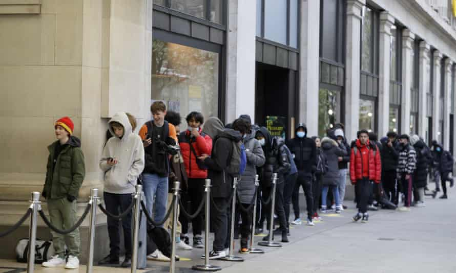 People queue to enter Selfridges department store on Oxford Street