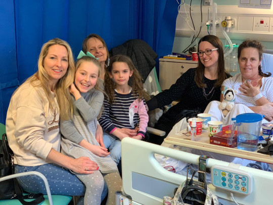 Annabel Lovick  in hospital with her sisters Lucy (l) and Laura (r) and nieces Alyena and Belle