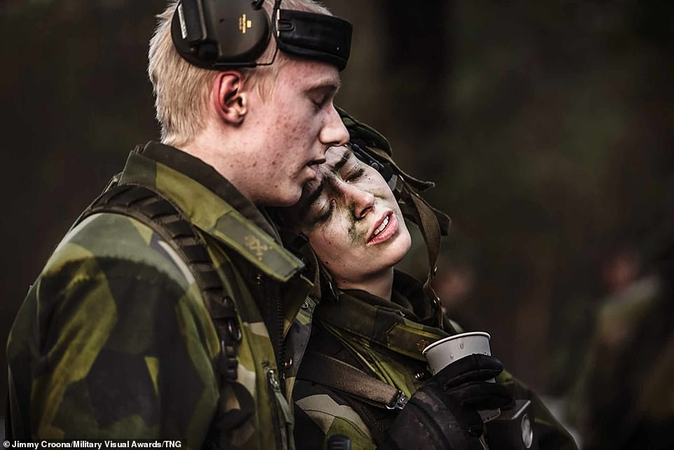 In a more emotional moment, Jimmy Croona captures the scene when recruits from Sweden's National CBRN Defense Centre completed the Never Give Up exercise which means they are now part of the Swedish Armed Forces, and no longer recruits but soldiers
