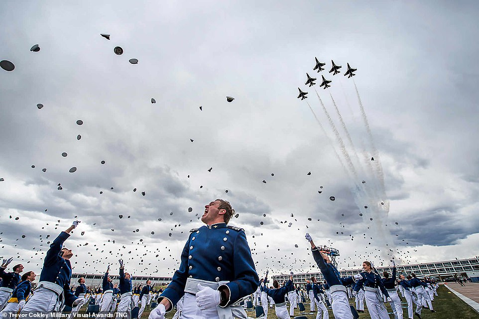 The US Air Force Academy Class of 2020 graduates toss their hats in the air as the Thunderbirds roar overhead during the graduation ceremony in Colorado Springs, Colorado in April 18, 2020. Nine-hundred-sixty-seven cadets crossed the stage to become the Air Force/Space Force's newest second lieutenants.