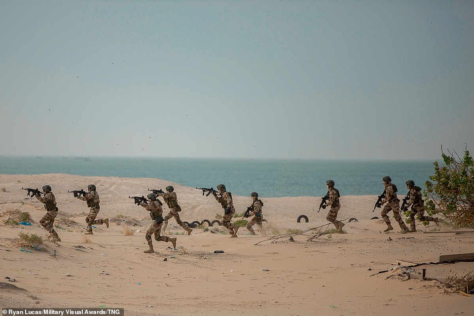 Members of the Republic of Guinea's armed forces take part in a simulated raid as part of the Flintlock Exercise in Nouakchott, Mauritania, Africa, on February 26, 2020. Flintlock is an annual, African-led integrated military and law enforcement exercise.