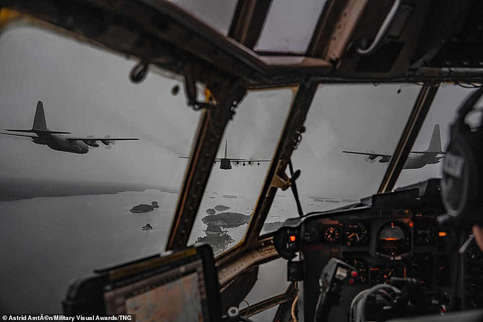 Swedish photographer AstridAmtén captured the impressive view of an undisclosed coastline from a cockpiut ansportation squadron during formation flight training with C130 (Hercules).