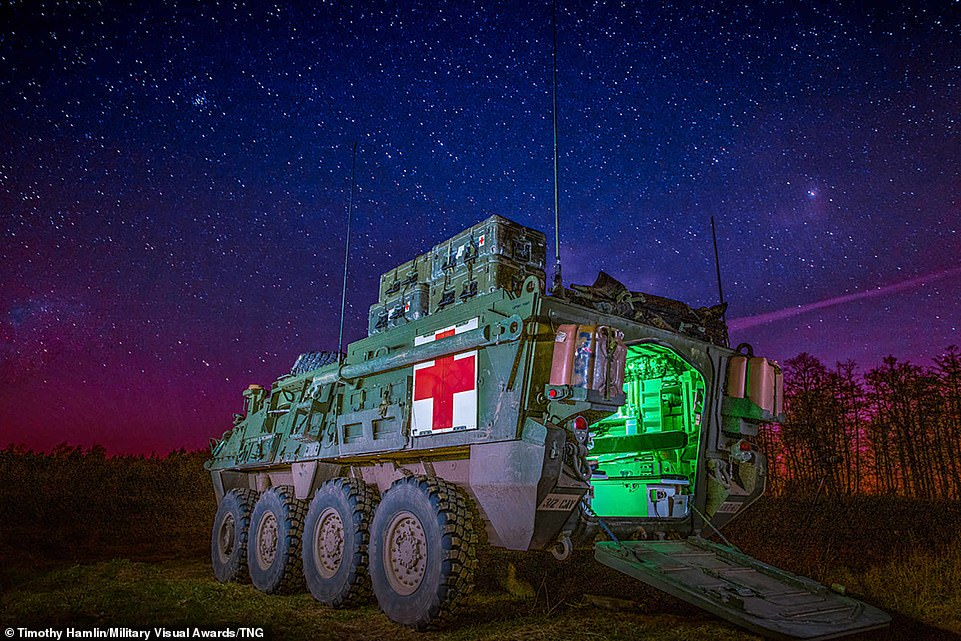 The background of a colourful night's sky made this picture all the more impressive as medical evacuation Stryker, assigned to the 3rd Squadron, 2d Cavalry Regiment, stands by during an artillery live-fire exercise in Bemowo Piskie, Poland, on April 27, 2020