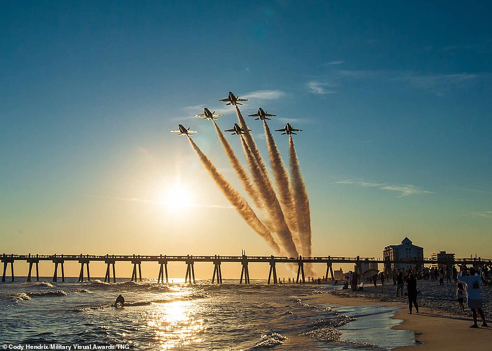 Photographer Cody Hendrix submitted this impressive image of the US Navy Flight Demonstration Squadron, the Blue Angels, conducting the final flight on the F/A-18 A/B/C/D 'Legacy' Hornets over the ocean as the sunset in Pensacola, Florida