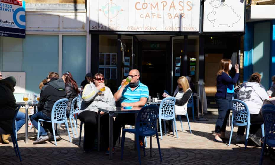 People enjoy drinks in the sunshine outside a bar near the Winter Gardens Blackpool.