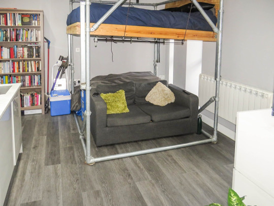 studio apartment in bristol with bed above sofa