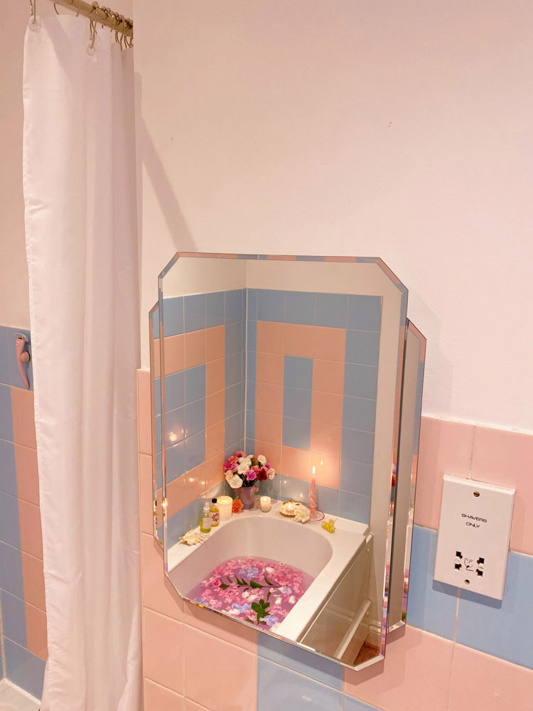 what I Rent: Zeena, one-bedroom flat in Hackney - bathroom with bathtub filled with flowers