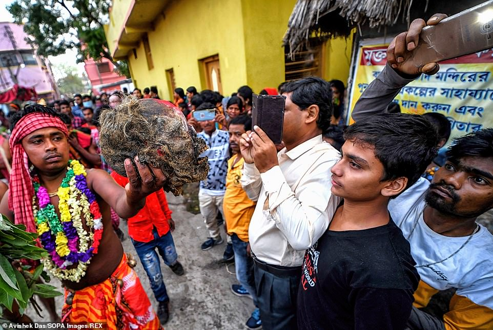 Hindu devotees held up the human skulls and pointed them right in front of cameras for passersby who had stopped to take pictures and record the unusual ritual,