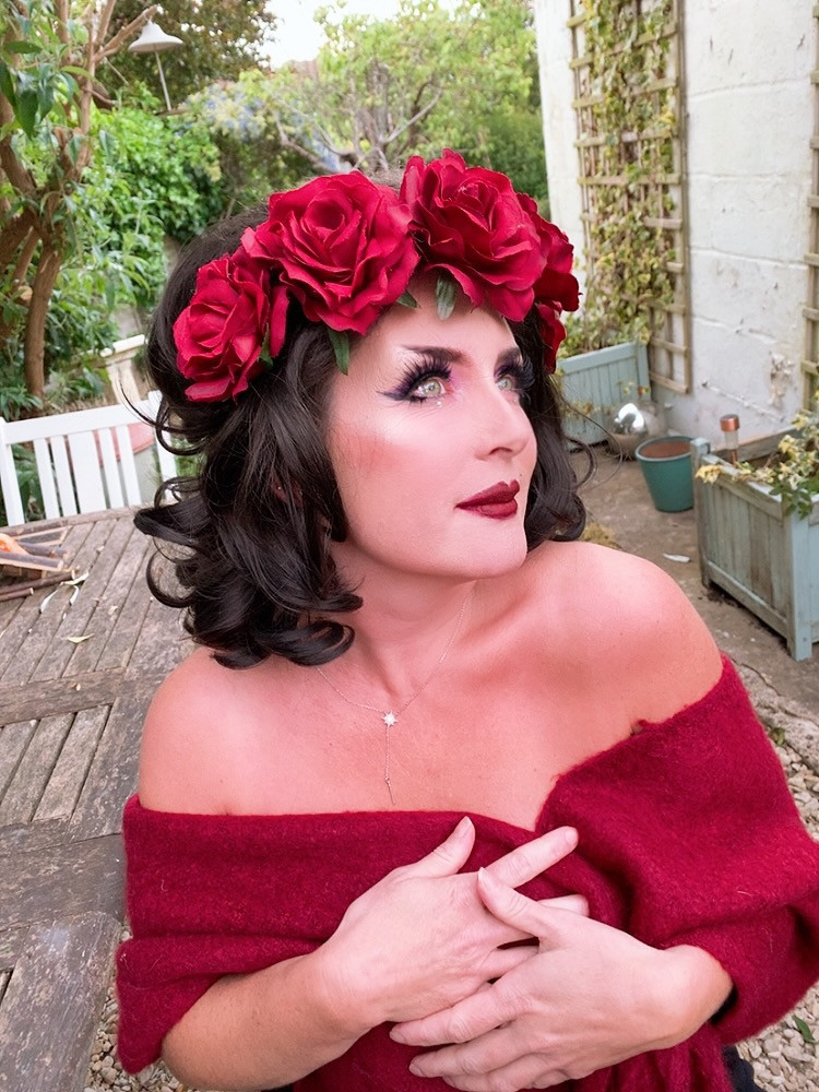 Jack Shute's mother in full drag make-up and rose crown in wig