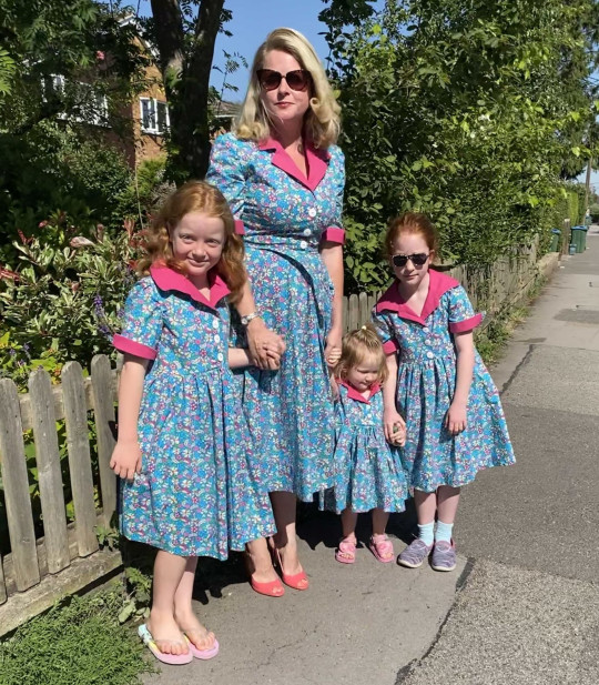 PIC FROM Kennedy News and Media (PICTURED: L-R POPPY CHANDLER, NINE, ROSIE CHANDLER, 39, DAPHNE CHANDLER, THREE, AND NINE-YEAR-OLD IRIS CHANDLER WEARING MATCHING HOME-MADE DRESSES) A glam mum who couldn't afford her dream 50s wardrobe but refuses the 'drudgery' of being a stay-at-home mum instead makes her own beautiful dresses - from charity shop bedsheets, tablecloths and even CURTAINS. Rosie Chandler, from Aylesbury, Buckinghamshire, doesn't like the 'mum uniform' of jeans and a top and wanted to embrace glamorous mid-century fashion styles on a daily basis. However her fashion heart and her wallet didn't match, with the 39-year-old full-time mum finding professional reproduction dresses costing ??160 a pop too pricey for her budget. DISCLAIMER: While Kennedy News and Media uses its best endeavours to establish the copyright and authenticity of all pictures supplied, it accepts no liability for any damage, loss or legal action caused by the use of images supplied and the publication of images is solely at your discretion. SEE KENNEDY NEWS COPY - 0161 697 4266