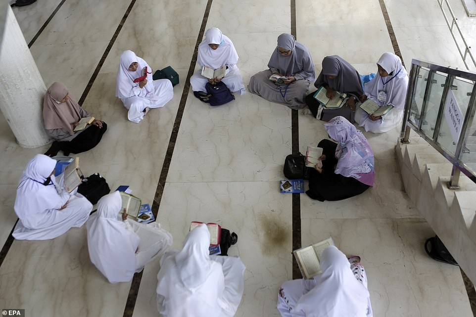 2021: A group of teenagers in Indonesia read and memorise the Quran at a mosque in Banda Aceh during the holy month of Ramadan