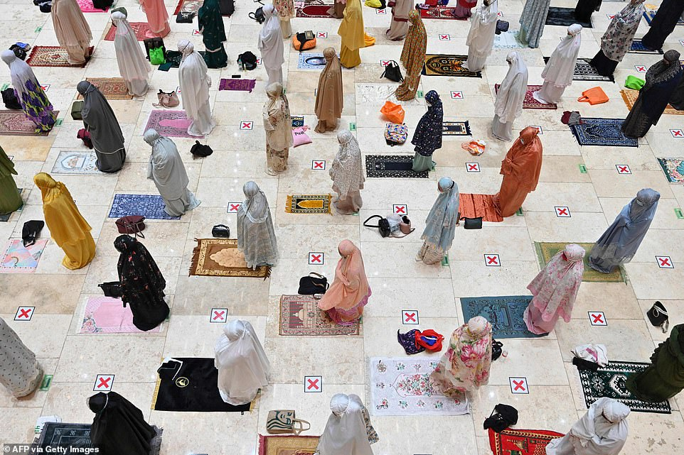 2021: Muslim women, who pray separately from men in mosques, are pictured praying in a socially distanced manner on the first night of Ramadan