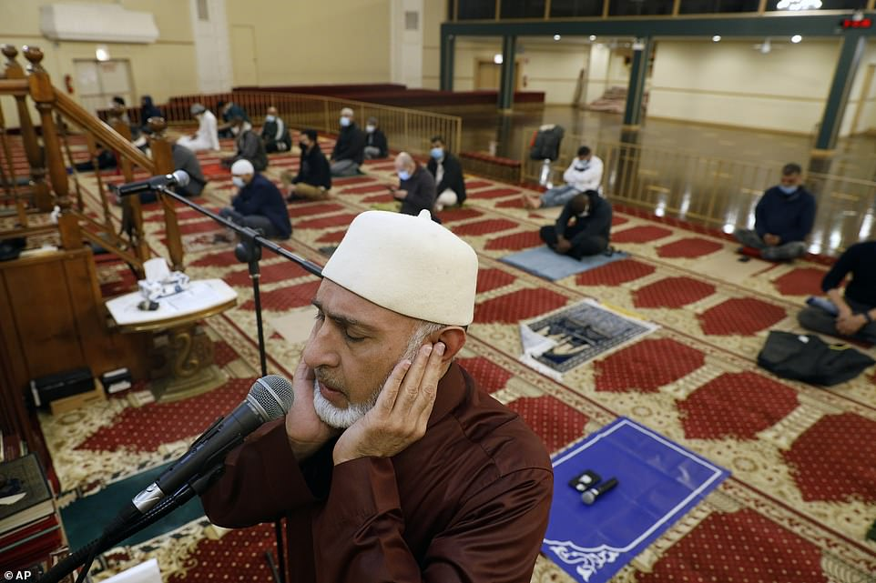 2021: Yusuf Omar, coordinator of Chicago's Muslim Community Center, performs the Adhan, or call to prayer, as Muslims are welcomed back to mosques after a year of Covid-19 restrictions, for Ramadan