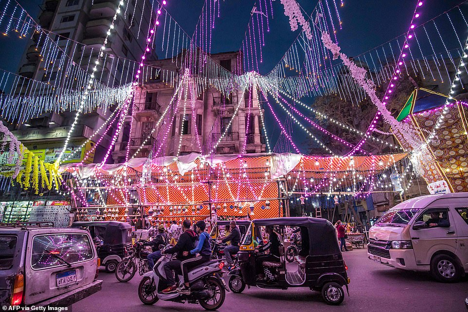 2021: A stall in the northern Cairo suburb of Shubra sells Ramadan lanterns on a busy street at the start of the Islamic holy month of Ramadan