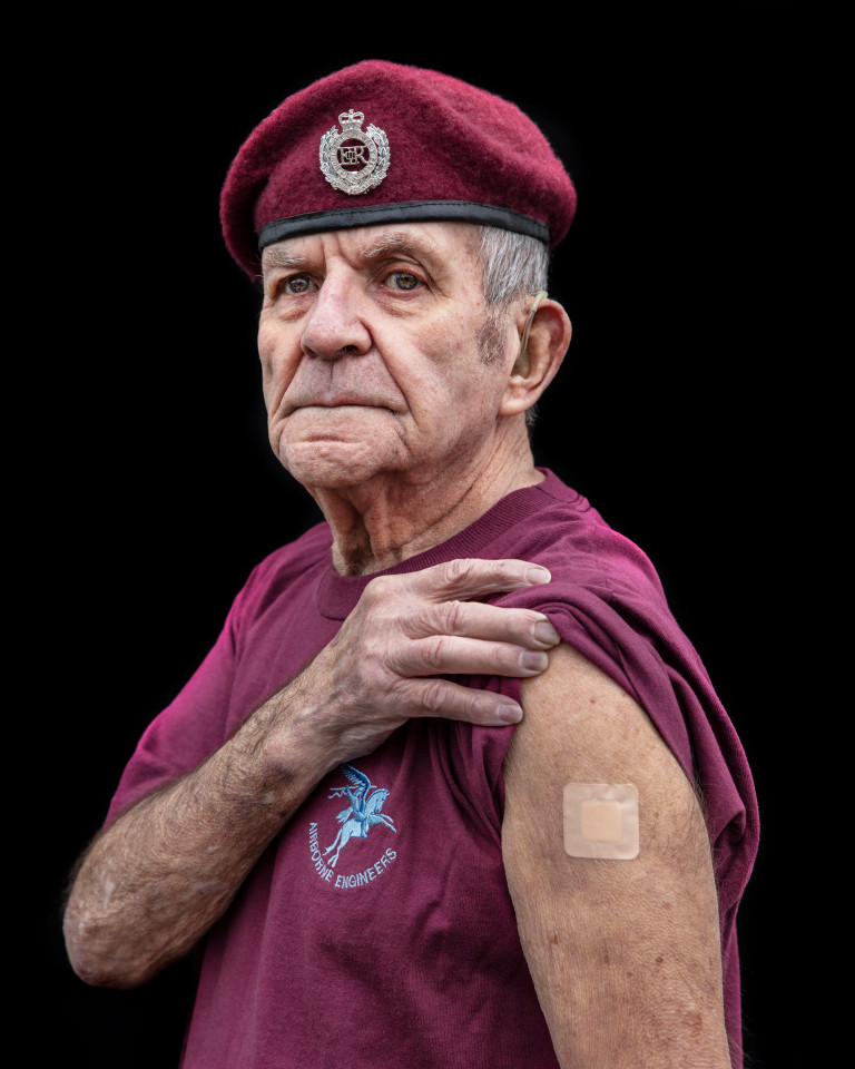 Badge of Honour - Vaccine Portraits Len Clark Age 88, Retired but was ex-member of the 9th Parachute Squadron It was important I got the vaccine as I am old and I have a pace maker so I don?t think it would have gone so well if I caught the bug. The vaccine is an amazing achievement and there is nothing to worry about. Just do it! My year of covid to be quite honest has been absolute murder! Locked in doors and not seeing relatives has made me feel like a caged animal and sometimes I have been so down. I have got confused what day it was and who cares anyway, there all the same. I have lived through the Blitz and in 1942 when I was 9 our home in the East End of London was blown up and I was evacuated to Hungerford in Berkshire. Back then there was comradeship and a real feeling of community, were as today we are forced to separate because of the virus and that has made today seem much harder. I feel proud to have been one of the first to get the jab, I might be old but I was showing the way. We are lucky to have such a great set of scientists and NHS workers pulling together and saving the country from this hideous bug.