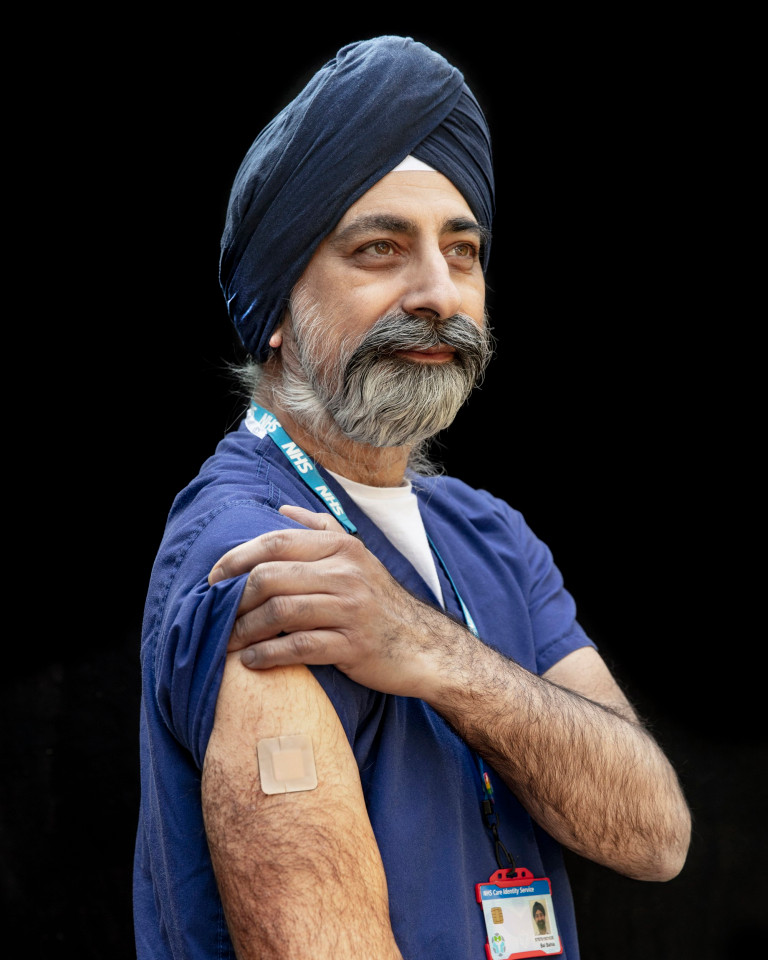 Badge of Honour - Vaccine Portraits Bal Bahia 1. aged 54, GP Partner. 2. Leading by example, protecting myself and those I look after. 3. I would want to speak to those people and find out what their concerns are? 4. A mixture of fear driven adrenaline and the community spirit of people coming together whilst refocusing on what?s important.