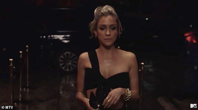 Here she is:The final few seconds of the teaser shows Kristin walking inside the restaurant and taking off her face mask