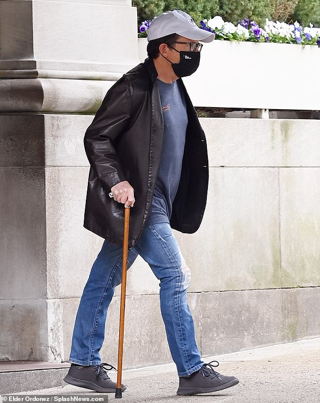 Heading out in Manhattan: Fox was seen walking with the help of a cane as he left his apartment in New York City on World Parkinson's Day, April 11