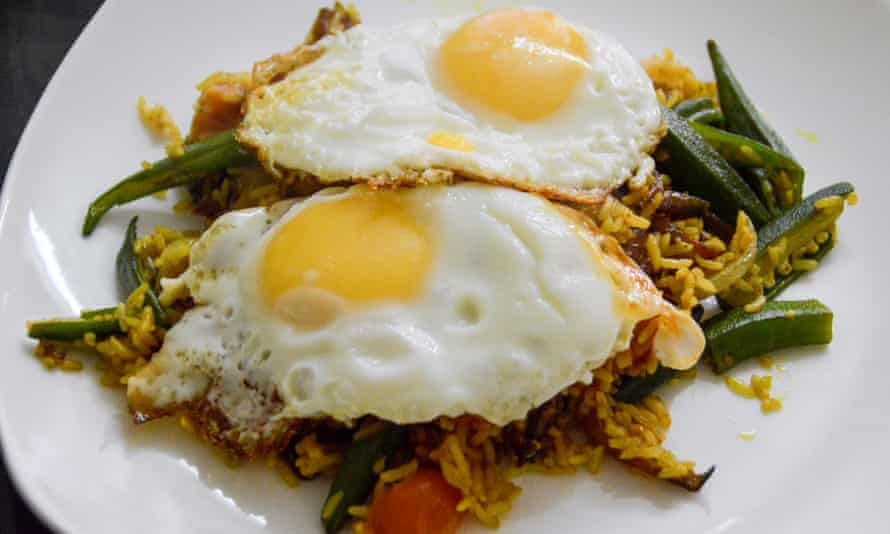 Vegetable biryani rice topped with fried egg