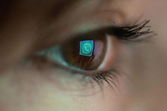 Human eye showing a reflection of the WhatsApp logo (Getty)