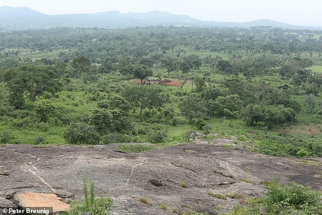 Pictured, the view from a granite hill of the Ifana excavation site (in the distance) during the rainy season