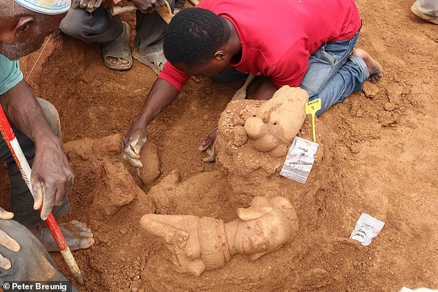 Pictured, stunning Nok culture terracotta figurines are excavated at the Ifana site in Nigeria as part of the dig