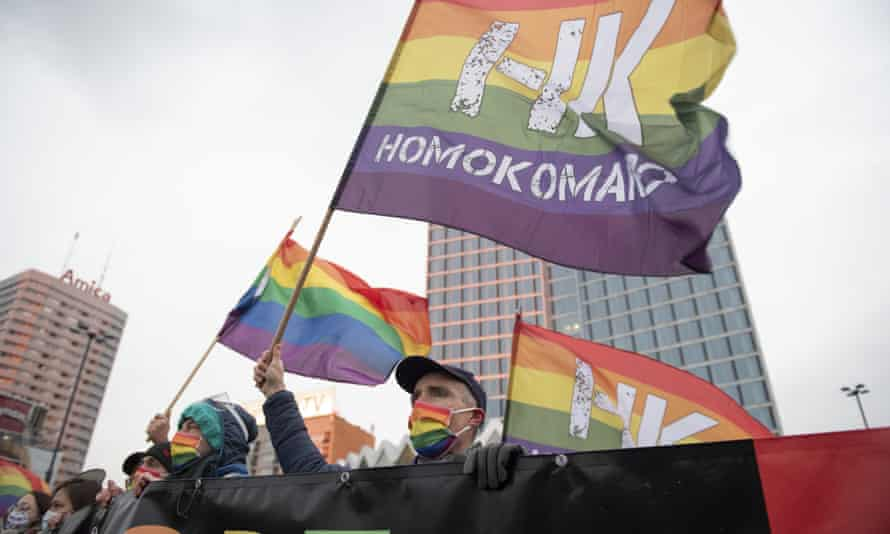 Demonstrators from the LGBTQ+ group Homokomando take part in a rally to show solidarity n Warsaw