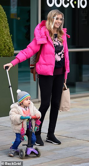 Doting mother: Rachel was seen pushing daughter Maven around in a push along scooter