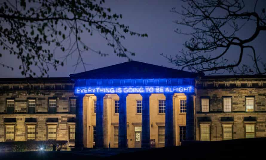 """The neon lights over museum entrance reading """"Everything is Going to be Alright"""" ."""