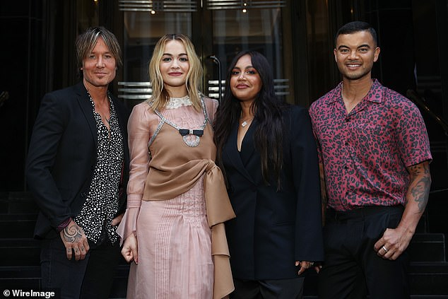 Friends: In contrast to the rumours that typically follow The Voice, insiders say the celebrity judges all got along 'swimmingly' this year. Pictured (left to right): Keith Urban, Rita Ora, Jessica Mauboy and Guy Sebastian on February 17, 2021, in Sydney
