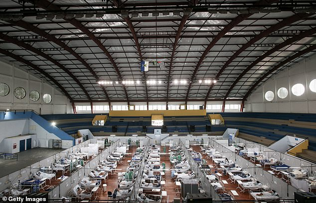 The outbreak is pushing hospitals to breaking point with many patients dying before an Intensive Care Unit bed becomes available (pictured, a field hospital in Santo Andre)