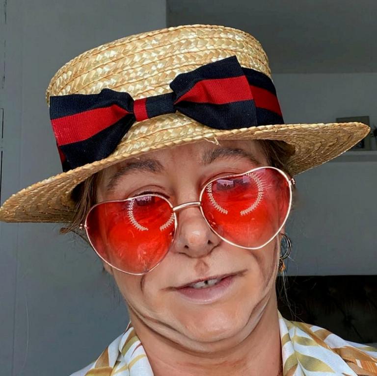 Liss Lacao as Elton John