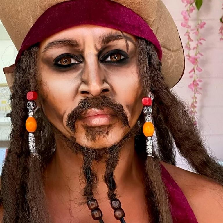 Liss Lacao paints her face as Captain Jack Sparrow