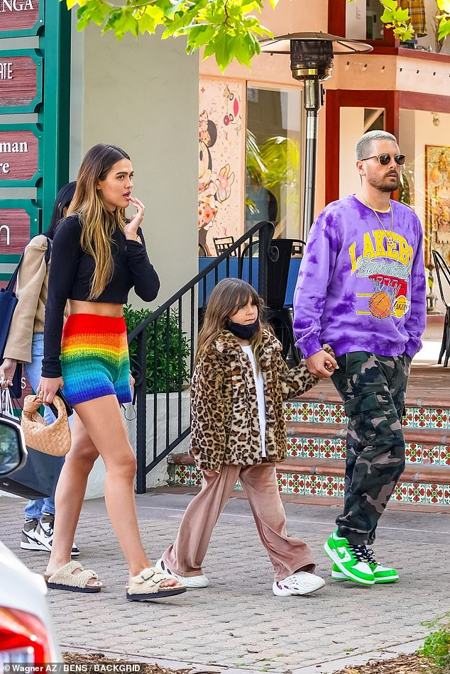 Stepping out: The brunette beauty put on a leggy display in a rainbow coloured miniskirt, while Scott rocked a Lakers basketball purple sweater