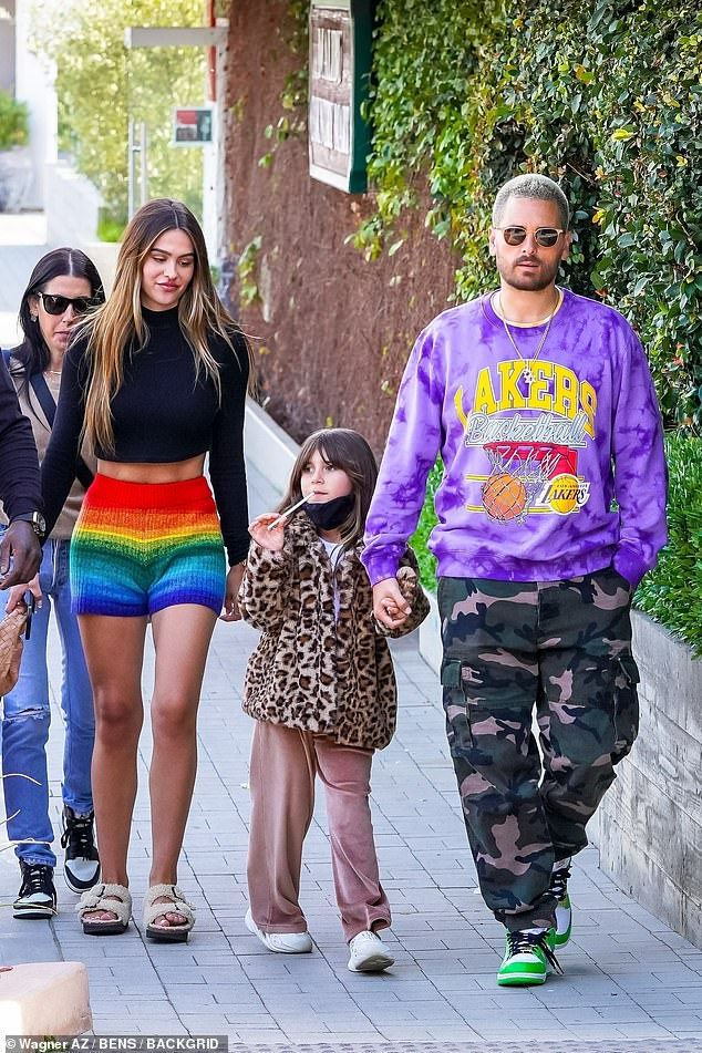 Adorable:Penelope, meanwhile, looked adorable in a leopard print coat and pink velvet flares as she held onto her dad Scott's hand during the shopping trip