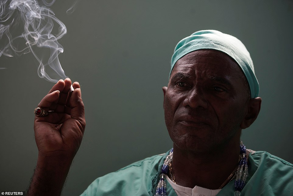 The heavy drinking and smoking Cuban healer claims he was visited more than 30 years ago by a spirit who told him to start healing people with his machete