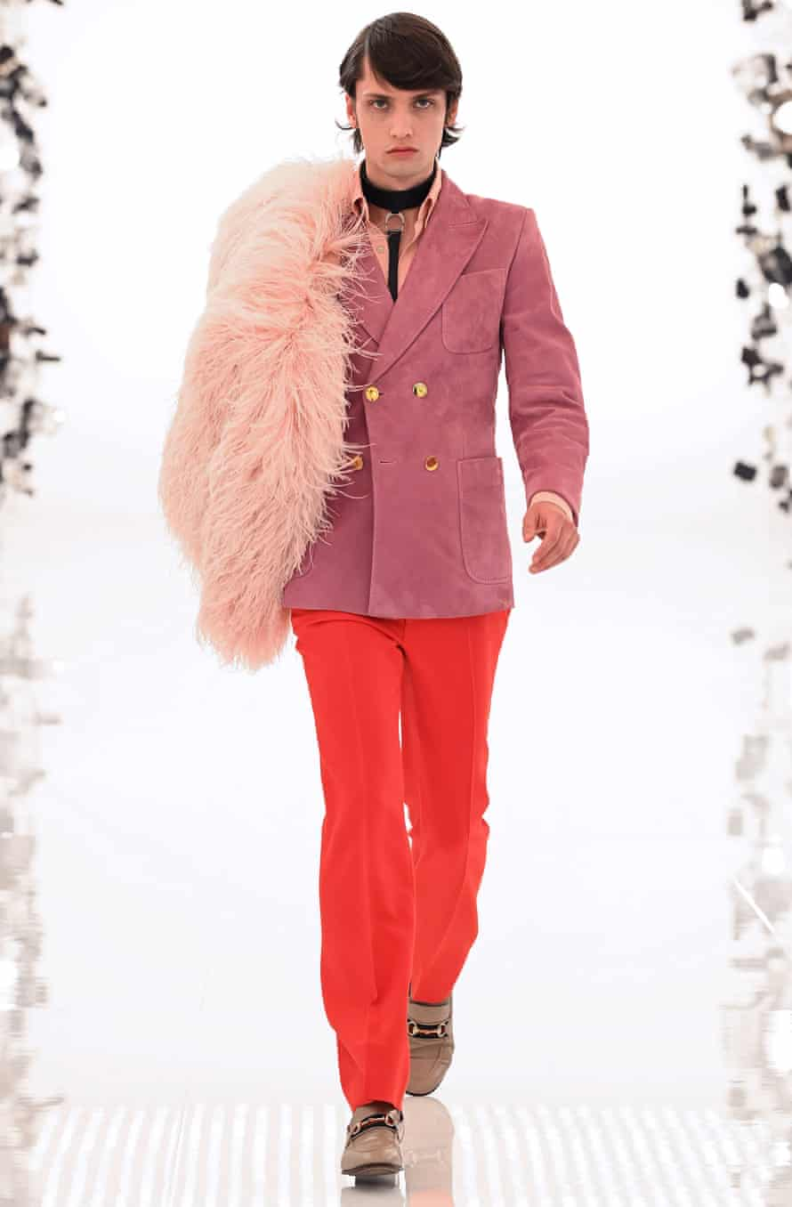 male model in pink jacket and orange trousers